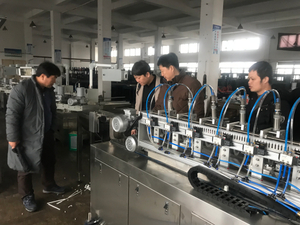 Korea customer visiting and checking paper straw machine in the factory