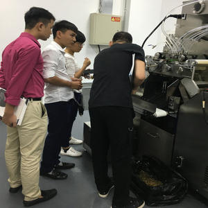 Customer from Vietnam inspecting full automatic encapsulataion machine
